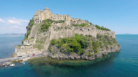 Fantastic aerial view of Italian medieval Aragonese Castle in Gulf of Naples Footage