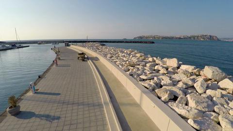 Tidy mooring for boats and yachts, morning walk at seaside, summer vacation Footage