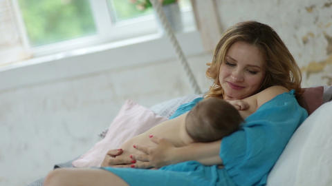 Loving mother looking at her adorable baby girl Footage