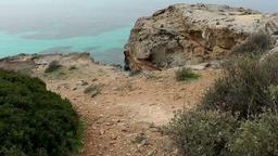 Spain Mallorca Island Cala Blava 015 on a rocky plateau at shore Footage