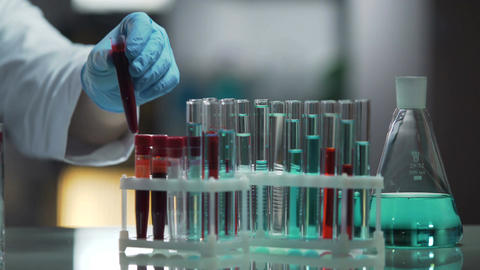 Laboratory working surface occupied by test tubes and flasks, research process Footage