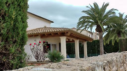 Spain Mallorca Island Cala Blava 018 veranda of noble villa behind stone wall Footage