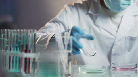 Researcher conducting scientific studies to confirm the quality of cosmetics Footage