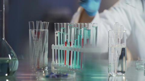 Laboratory scientist conducting tests by adding drop of reagent to mixture Footage