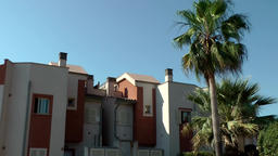 Spain Mallorca Island Cala Blava 035 red and white colored spanish row house Footage