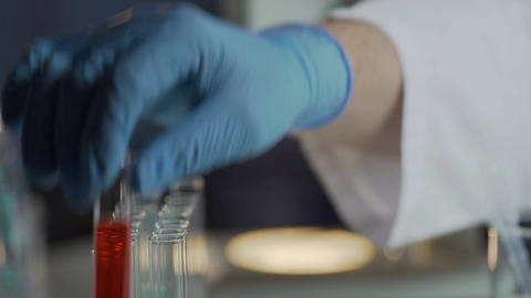Scientific lab conducting research of various diseases using blood samples Footage