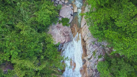 Drone Quickly Approaches River Waterfall Running into Lake Footage