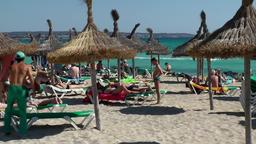 Spain Mallorca Island Playa de Palma 006 natural straw sun shades on the beach Footage