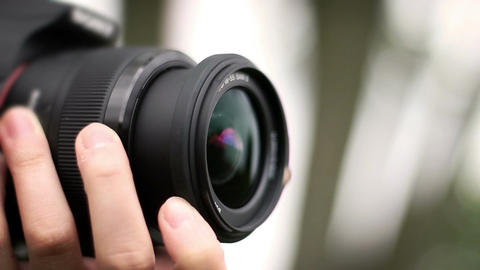 Close up of DSLR camera recording video or shooting photographs Footage