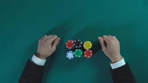 Risky poker player bets all-in, man stakes money on... Stock Video Footage