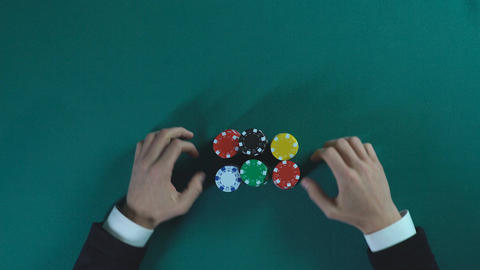 Risky poker player bets all-in, man stakes money on business project, gambling Footage