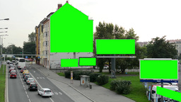 many billboards in the city near road - passing cars - people - nature (trees) - Footage