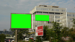 two billboards in the city near road (on the building) - green screen - building Footage