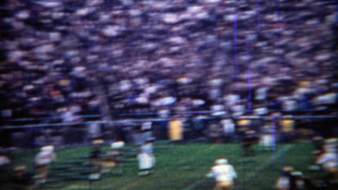 1969: Purdue college football team scores passing touchdown, crowd goes mad Footage