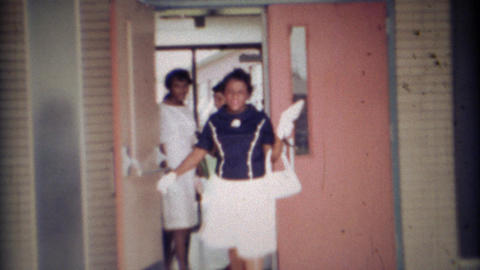 1969: School teacher leaving class early with her daughter Footage