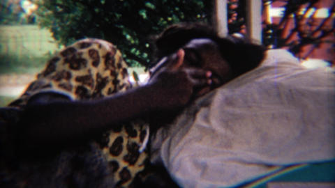 1969: African American girl itching her nose white laying down Footage