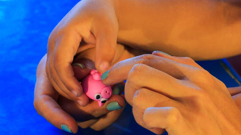 kid's and mother's hands sculpture toy animal of plasticine Footage
