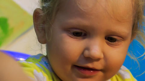 closeup small blonde girl eats ban Footage