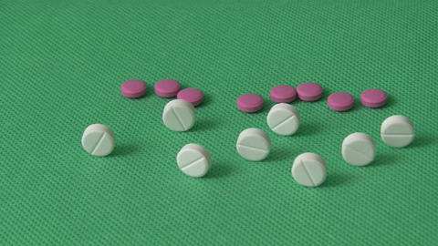 Pills on green background Footage