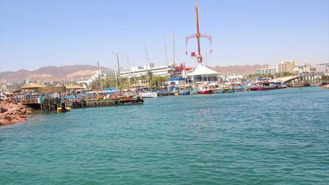 Boat tracking shot of the entrance to the marina of Eilat Footage