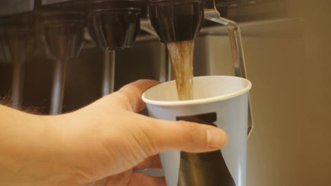 Closeup Man Fills Blue Paper Cup with Fresh Hot Coffee Footage