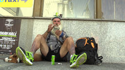 Authentic homeless poor man makes smokes a cigarette Footage