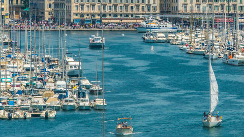 Yachts and motorboats leaving Marseille Vieux Port, busy water traffic timelapse Footage
