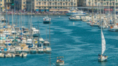 Busy traffic in Old Port of Marseille, boats sailing into open sea, timelapse Footage