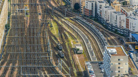 Passenger trains moving back and forth on railroad tracks, top view, timelapse Footage