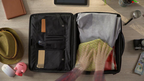 Travel suitcase packed quickly, preparations for vacation trip, time lapse Footage