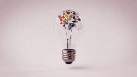 Colorful spheres animation inside a light bulb Animation