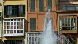 Spain Palma de Mallorca 018 fountain in front of colorful facade Footage