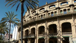 Spain Palma de Mallorca 031 shadows of palm trees on bullring facade Footage