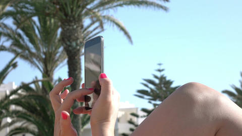 Video of woman using phone on the vacation in 4K ビデオ