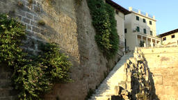 Spain Palma de Mallorca 111 overgrown old city wall with a steep stair Footage