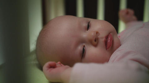 Side View of Awaking Newborn Baby Dolly Shot Close Up Footage