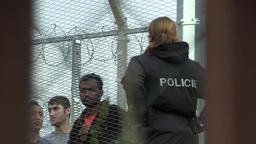 Refugees, immigrant placement in a detention camp in Vysni Lhoty, policeman talk Footage