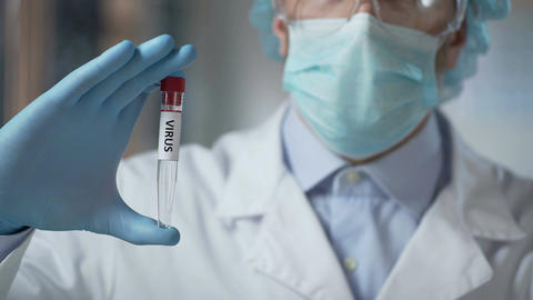 Lab researcher holding virus sample, illegal clinical trials, germ warfare tests Footage