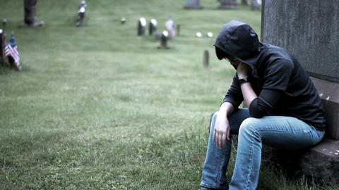 Color graded moody concept of dramatic gothic teenager in cemetery Footage