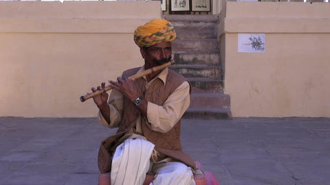 Indian musician man playing with bamboo flute in Mehrangarh fort, Jodphur Footage