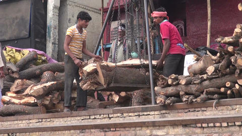 workers weighing firewood in sacred city Varanasi for people burning cremation r Footage