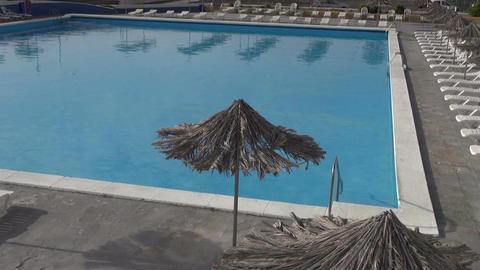 Beach umbrellas and swimming pool Footage