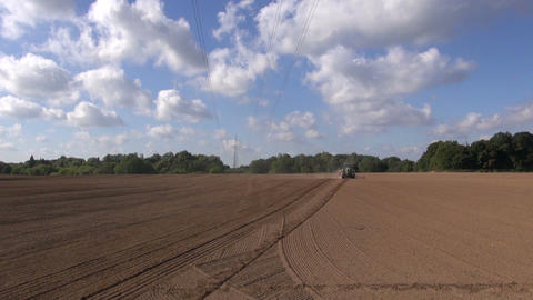 Tractor sowing in freshly plowed clay soil Footage