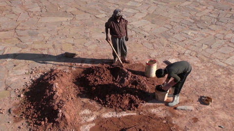 wo workers working with clay with primitive tools in Nahargarh fort, India Live Action