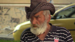 OLOMOUC, CZECH REPUBLIC, JULY 4, 2015: Authentic emotion homeless man senior ビデオ