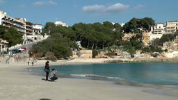 Spain Mallorca Island small town Porto Cristo 010 couple on empty beach Footage