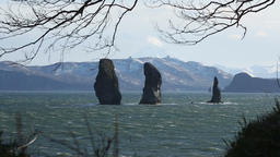 Kamchatka Peninsula seascape: Three Brothers Rocks in Pacific Ocean Footage