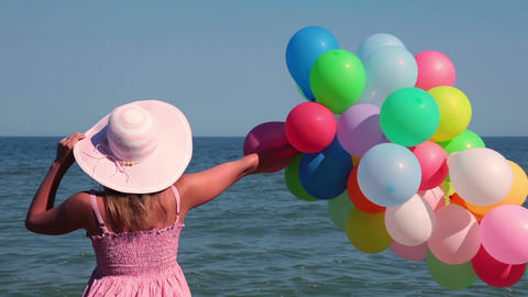 Girl with Balloons on the Beach Footage
