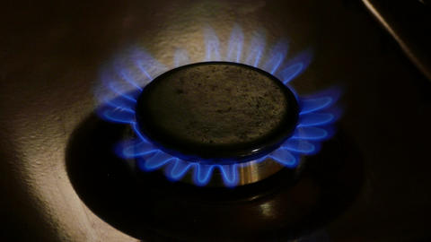 4K Ungraded: Burner Plate of Gas Stove Is Lit With Blue Flame Throughout Footage