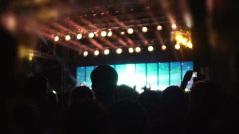 People slowly dancing in blurred lights of stage decoration, extra slow motion Footage